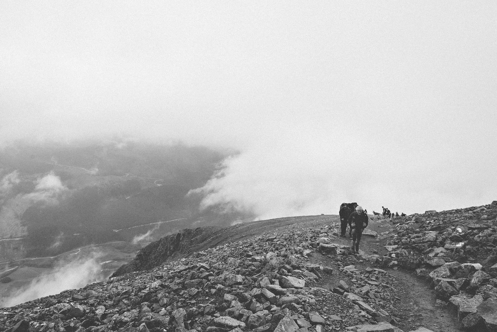 Climbers hiking atop Ben Nevis in Scotland