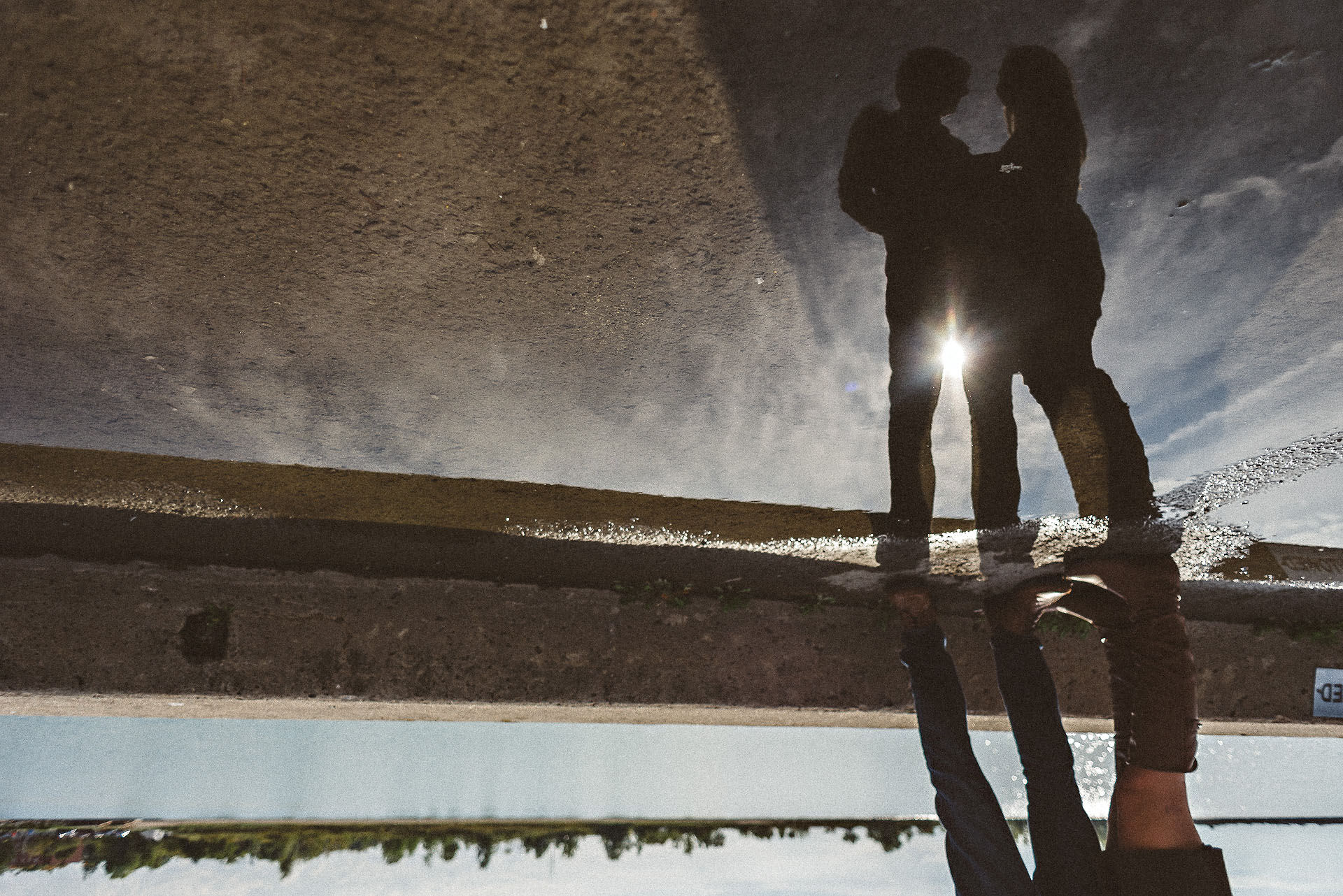 water reflection silhouette of couple