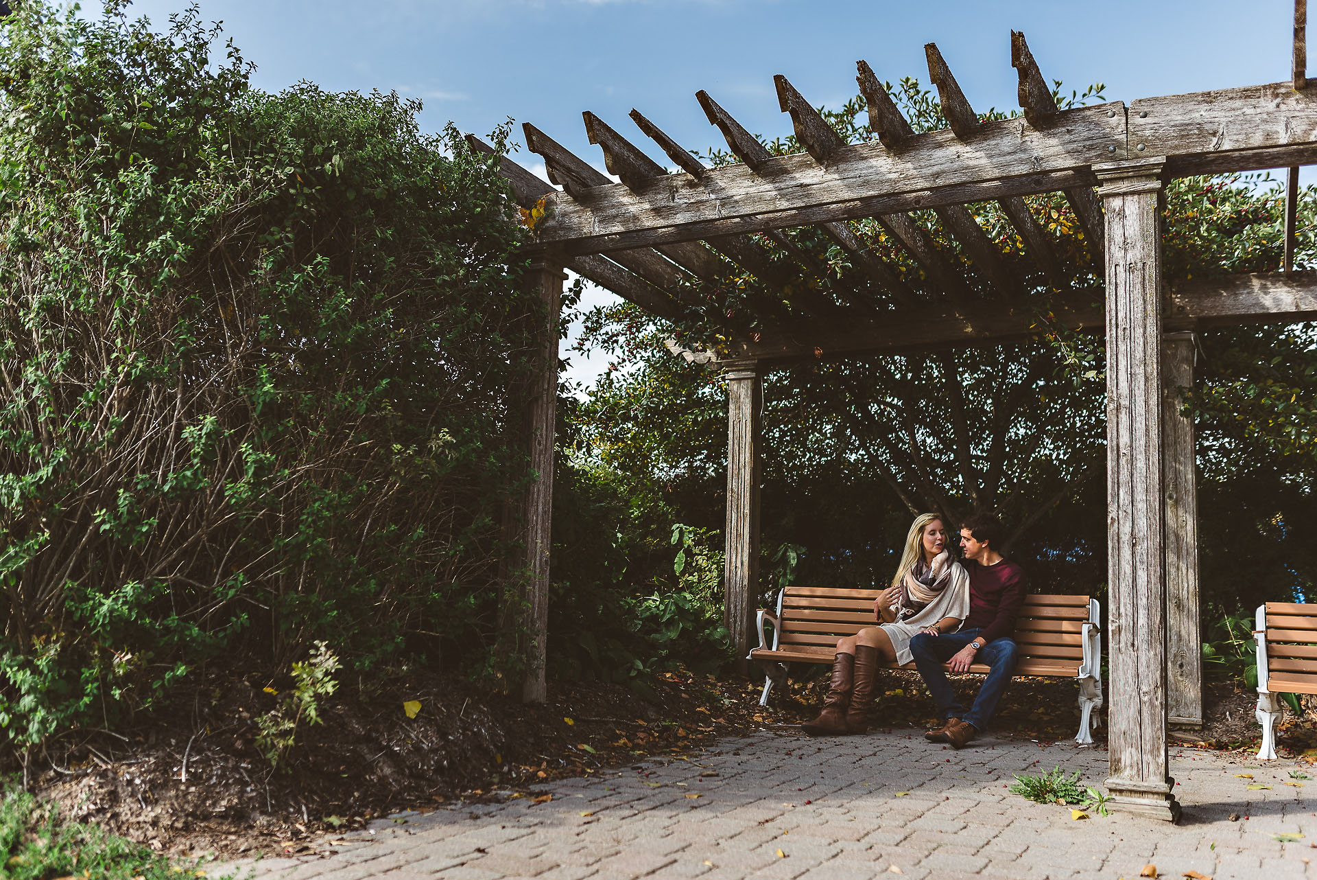 couple sitting on bench at cobourg beach