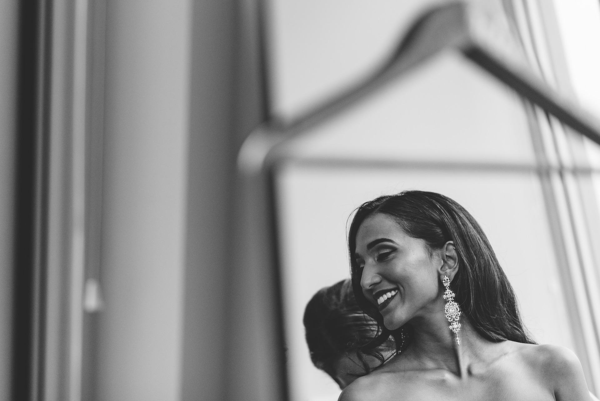 bride in mirror laughing