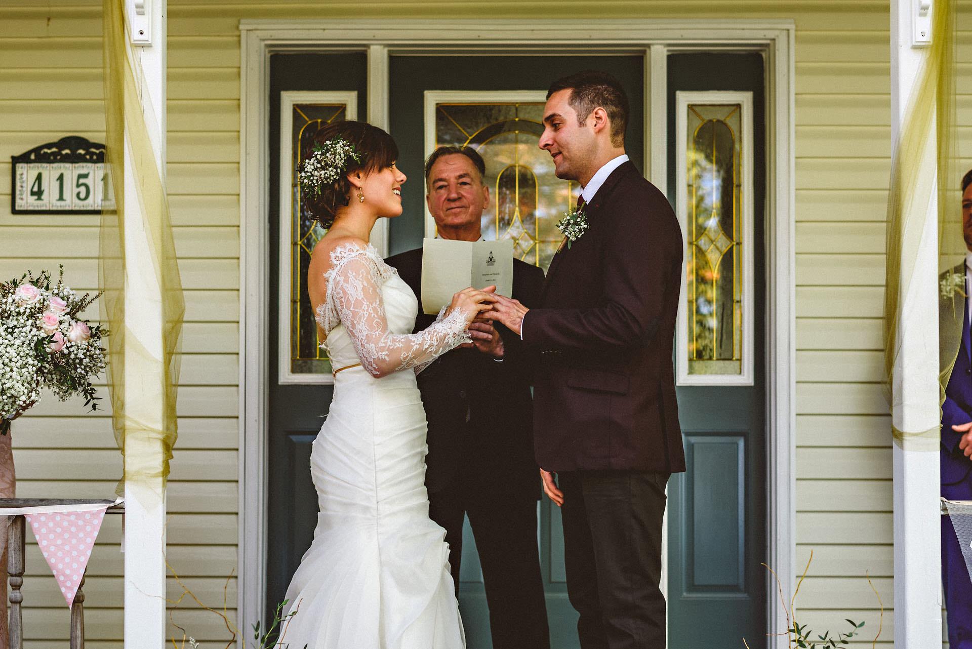 exchange of rings at a niagara backyard wedding