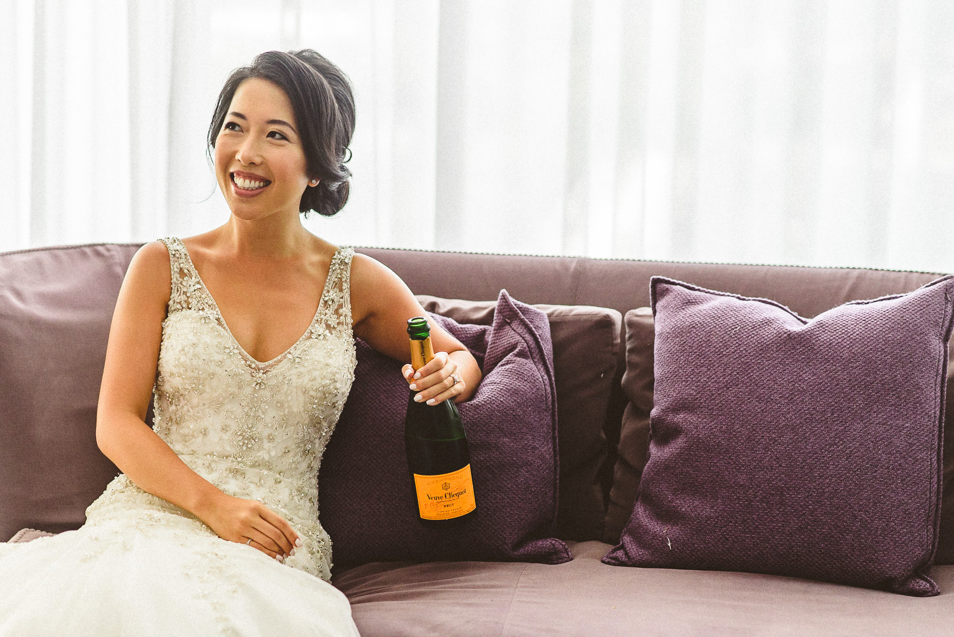 Bride drinking champagne at Thompson Hotel Wedding