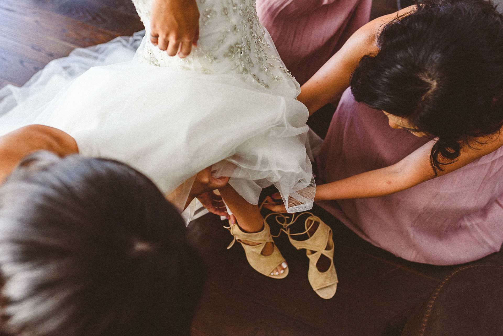 Bride getting help with dress