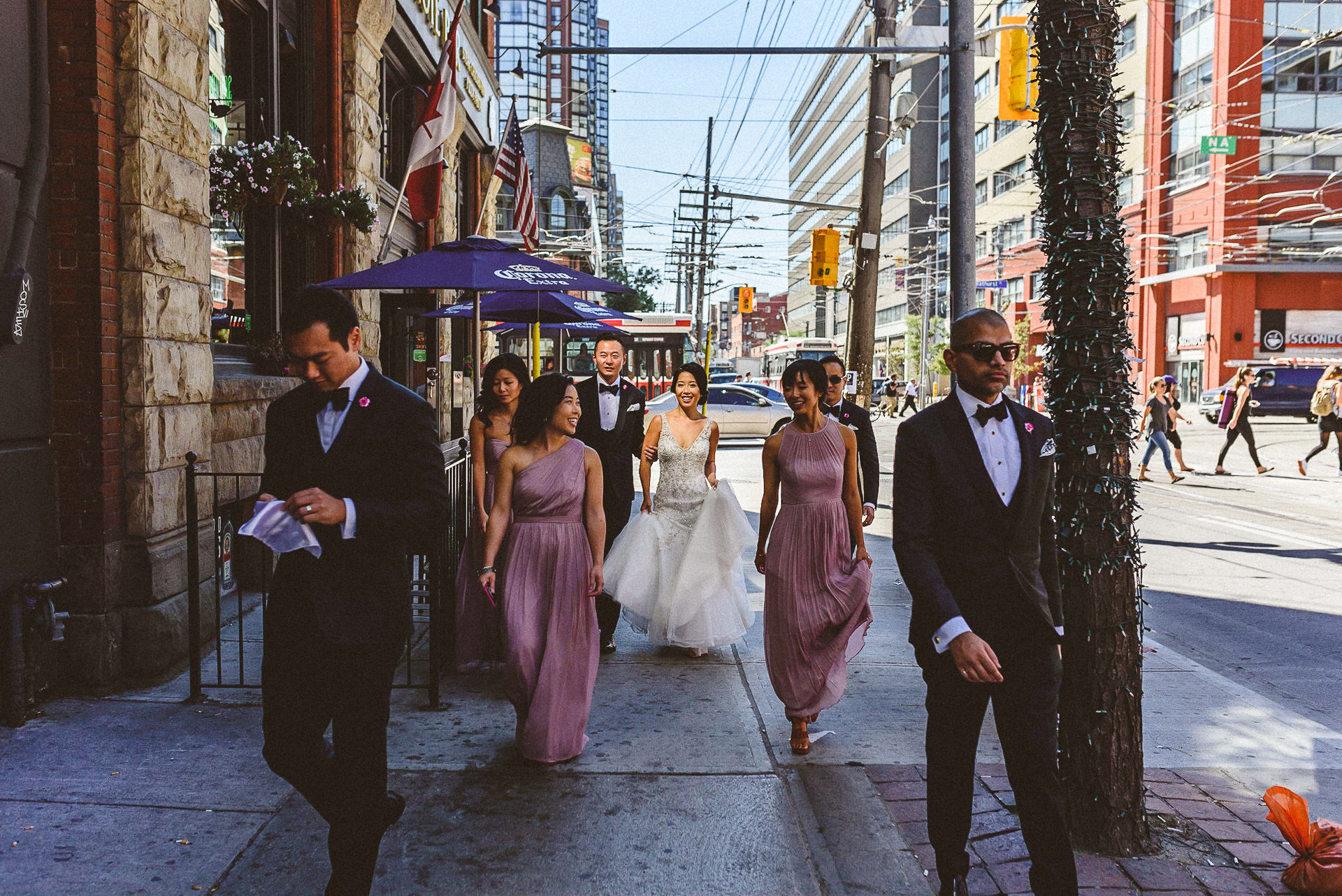 Wedding party walking down Queen St. W