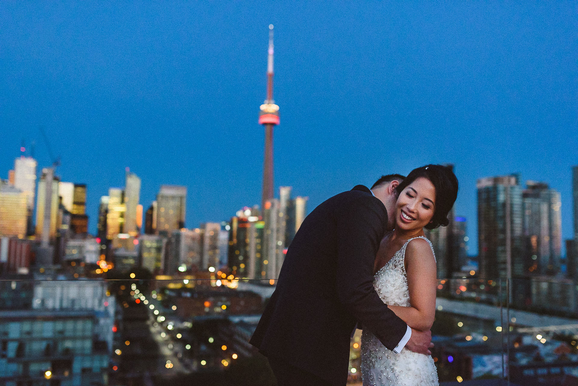 Amazing roof top CN tower portrait of couple at Thompson Hotel.