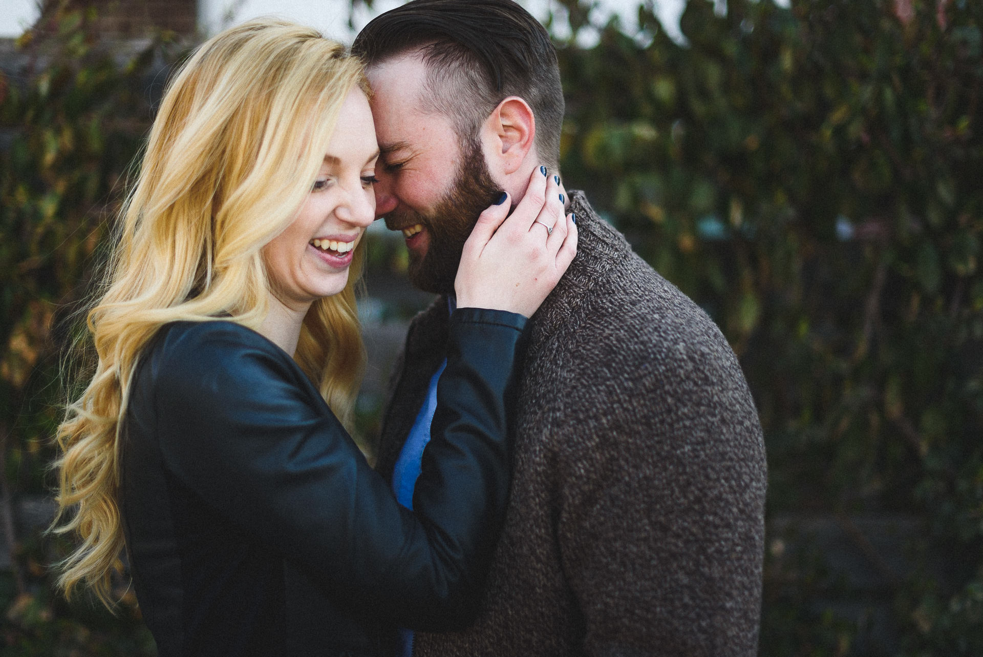 Laughing couple at Wychwood Barns Engagement Session