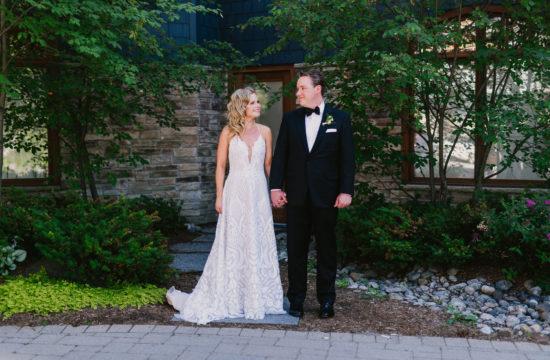 bride and groom holding hands during Marriott Rosseau Muskoka Resort Wedding