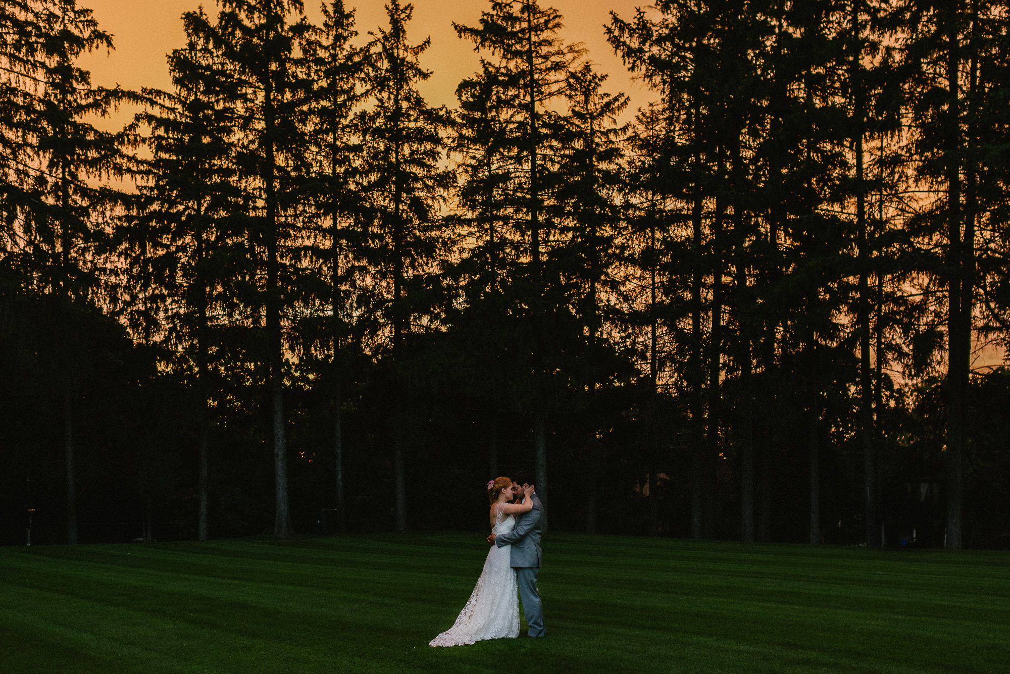 sunset portraits of couple at wedding at saint Andrew's college